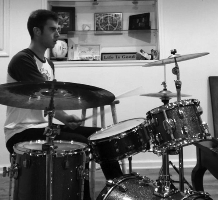 Senior Eric Quam showcases wide variety of talents as drummer, hockey player