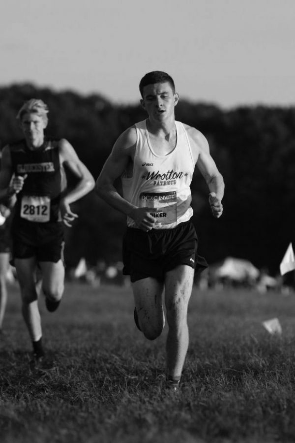 Senior John Riker stands out in roles as writer, runner, brother