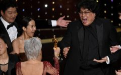 Oscars honor film industry, make history, shock viewers
