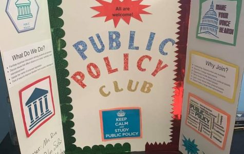 Junior Dylan Safai displays his poster board from last year's club expo for his club, Public Policy.