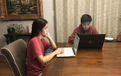 Sophomore Nick Kim works on homework alongside his older sister.