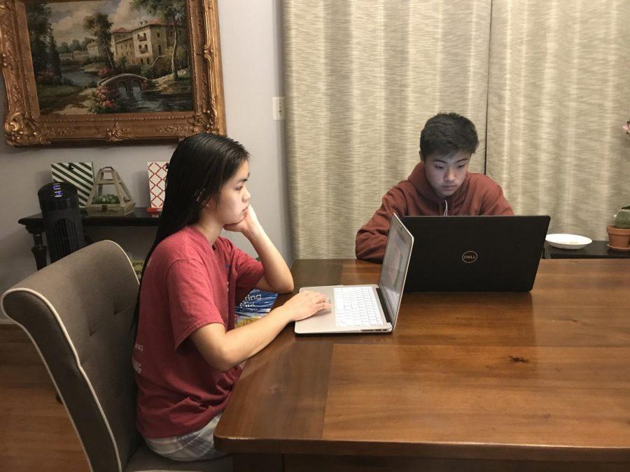 Sophomore+Nick+Kim+works+on+homework+alongside+his+older+sister.