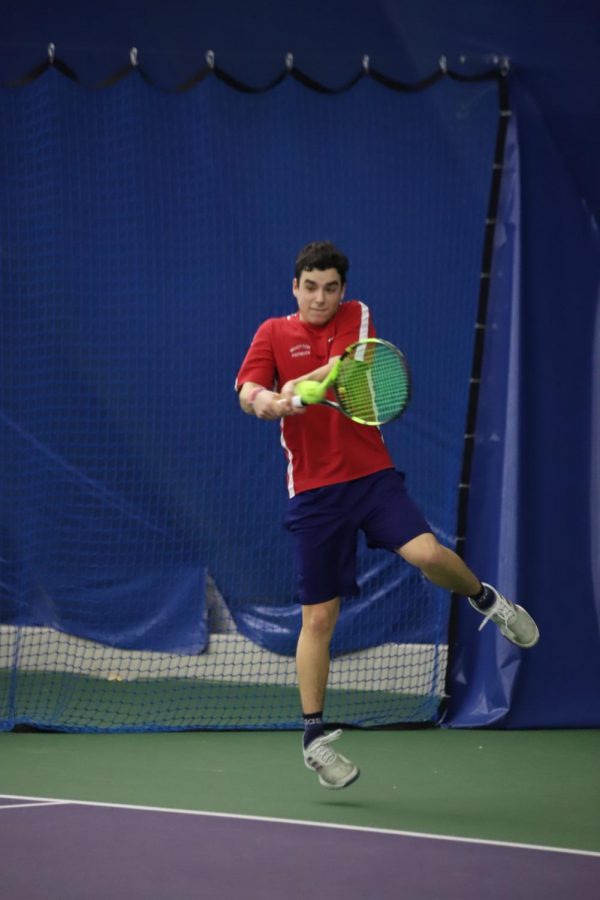 Senior+Ryan+Meyer+finds+time+to+practice+tennis+amidst+his+school+and+college+application+work.