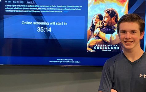 Junior Joshua M. Freedman enjoys watching an early premiere of the new film