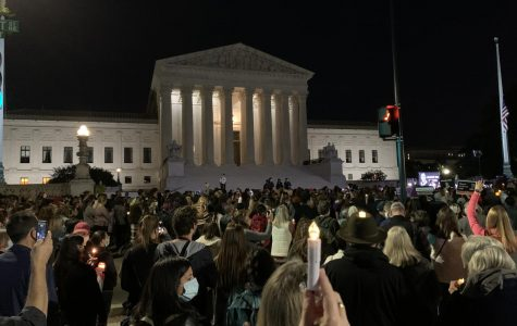 A large crowd gathers in front of the Supreme Court the night of Sep. 19 for a candle-lit vigil in honor of the late Justice Ruth Bader Ginsburg.