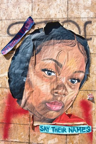 Artwork in memory of Breonna Taylor decorates the George Floyd Memorial.