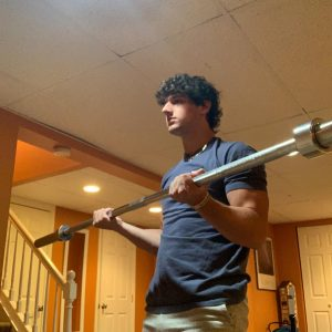Junior Nate Jacobs works out in his basement on Sept. 10 to prepare for the football season.