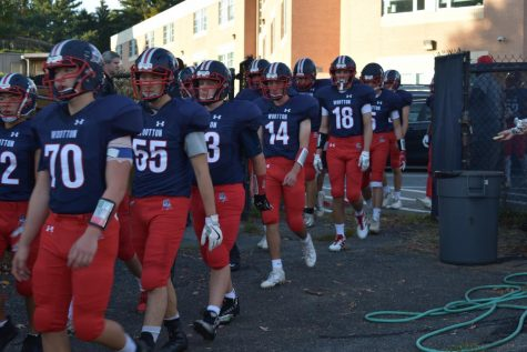 The varsity footballteam takes the field  against QO on Sept. 9, 2019.