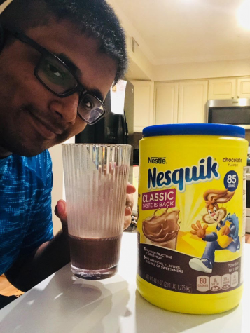 Senior Aryan Munot enjoys a glass of hot chocolate made with Nesquik chocolate mix.