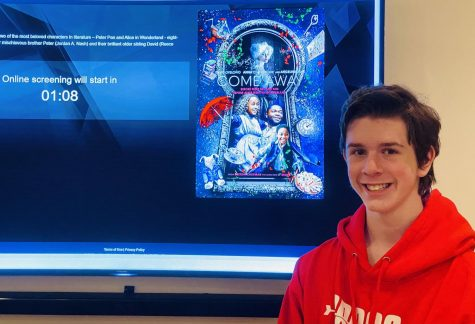 "Junior Joshua M. Freedman watches an early premiere of the new film ""Come Away"" at his house on  Nov. 12."