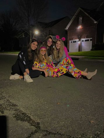 Freshman Zoe Heller hangs out with her sister, senior Tamara Heller, and her friends, senior Eleni Jones and senior Anna Daraselia, on Halloween night.
