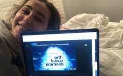 Sophomore Carli Katz gets comfy in bed to watch The Social Dilemma.