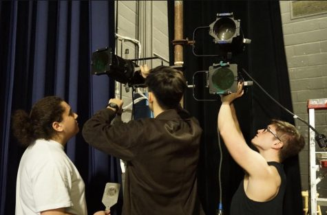 "Ben Mash, David Kolb and Stephen Rosov adjust lights used for ""Freaky Friday,"" which was performed during the 2019-2020 school year."