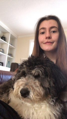 SADD club treasurer and junior Lizzy Jack enjoys spending time with her dog to relieve stress.