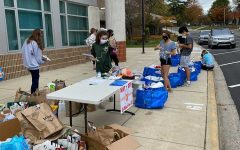 Wootton Families4Families Club packages food and supplies at their first drop off on Oct. 24.