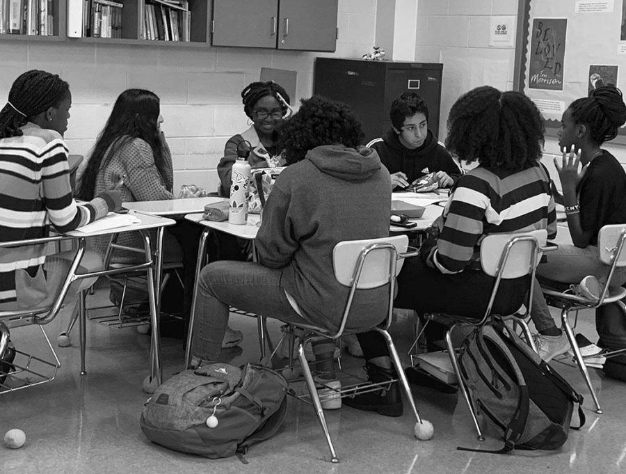 Students+sit+down+and+discuss+the+Minority+Scholars+Program%27s+purpose+at+a+meeting+on+Nov.+12%2C+2019.