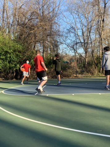 Sophomores, Parker Lebowitz, Ethan Kuan, Eli Goozh and Zach Hallegean play basketball while being socially distanced.