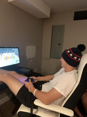 Sophomore Josh Erd plays video games on Oct. 29 after school. Erd enjoys playing video games because it gives him a break from school work.