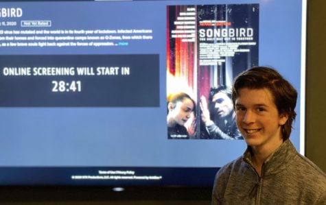 "Junior Joshua M. Freedman watches an early premiere of the new film ""Songbird"" at his house on Dec. 9."