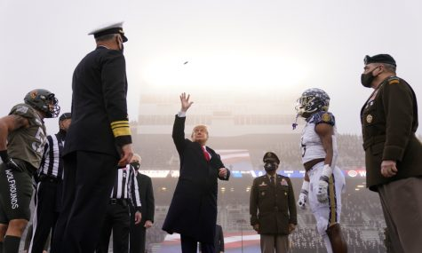 President Donald Trump flips the coin for the anticipated Army Navy football game.