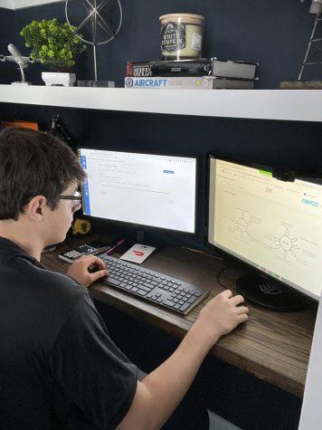 Junior Devon Graham works on his homework on Dec. 16 during lunch.