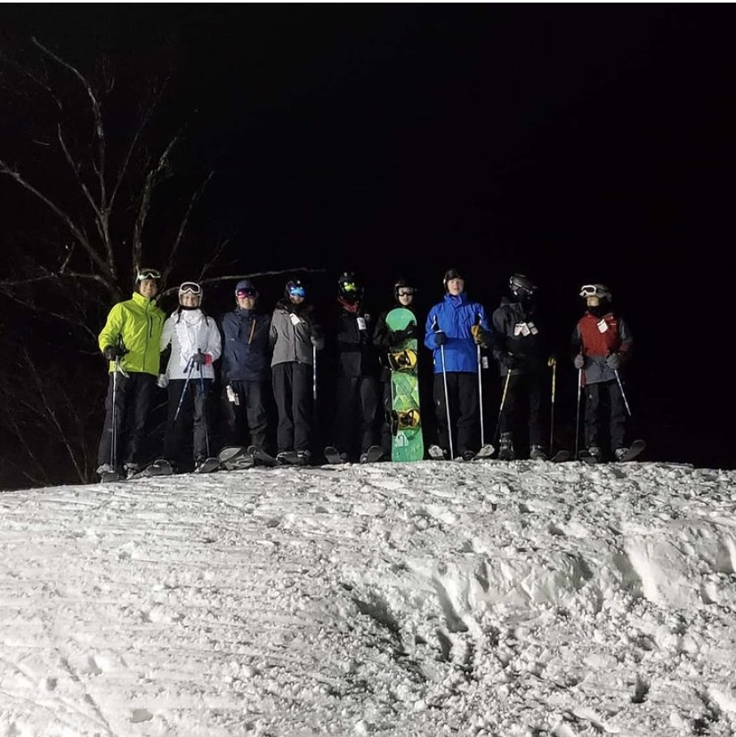 The ski club poses for a picture before skiing down a mountain at Whitetail Resort last January.