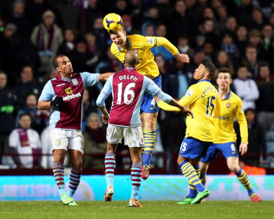 Per Mertesacker of Arsenal in action against Aston Villa players Gabriel Agbonlahor and Fabian Delph during the English Premier League soccer match between Aston Villa and Arsenal FC at the Villa Park in Birmingham, Britain, January 2014