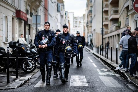 French Anti-Riot Police patrol the streets of Paris.