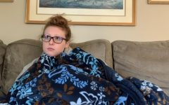 Senior Kelly Baldwin settles down after a long day of school to watch one of her favorite holiday movies, Home Alone.