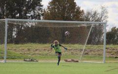Lindsey Walter blocks the ball at a soccer match.