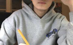Freshman Ryan Hu begins sketching his next piece in his art journal.