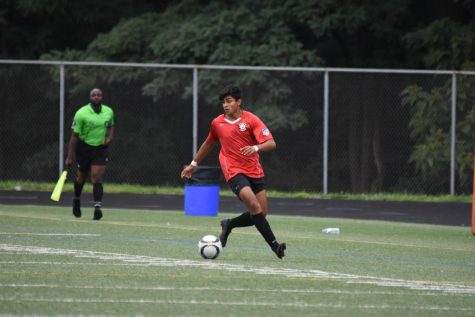 Devansh Mishra readies to kick the ball at a soccer game.