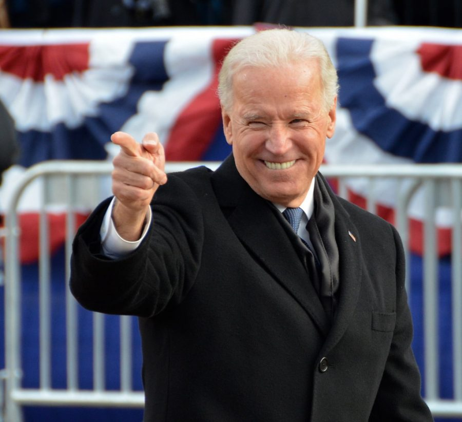 46th President of the United States Joe Biden points at the audience while leaving Inauguration.