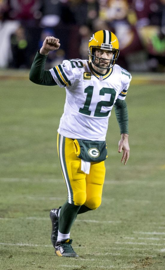 Aaron Rodgers celebrates after scoring touchdown on Jan. 16
