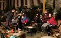 A group of Wootton juniors spend time together outside with masks on to prevent the spread of Covid.