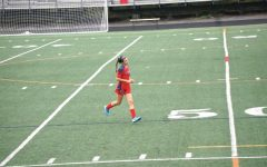 Jessica Winson warms up for her JV soccer game as a freshman.