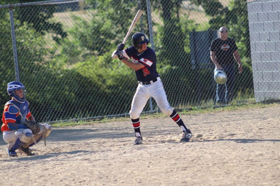 Junior James Walsh stands at the plate ready to receive the pitch.