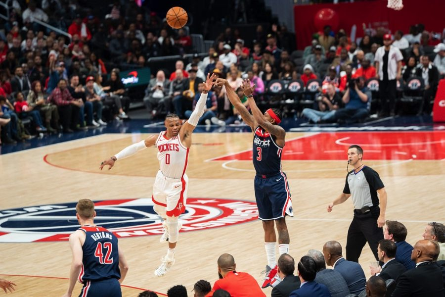 Wizards star Bradley Beal shoots over Russell Westbrook in a game during the 2019-2020 season.