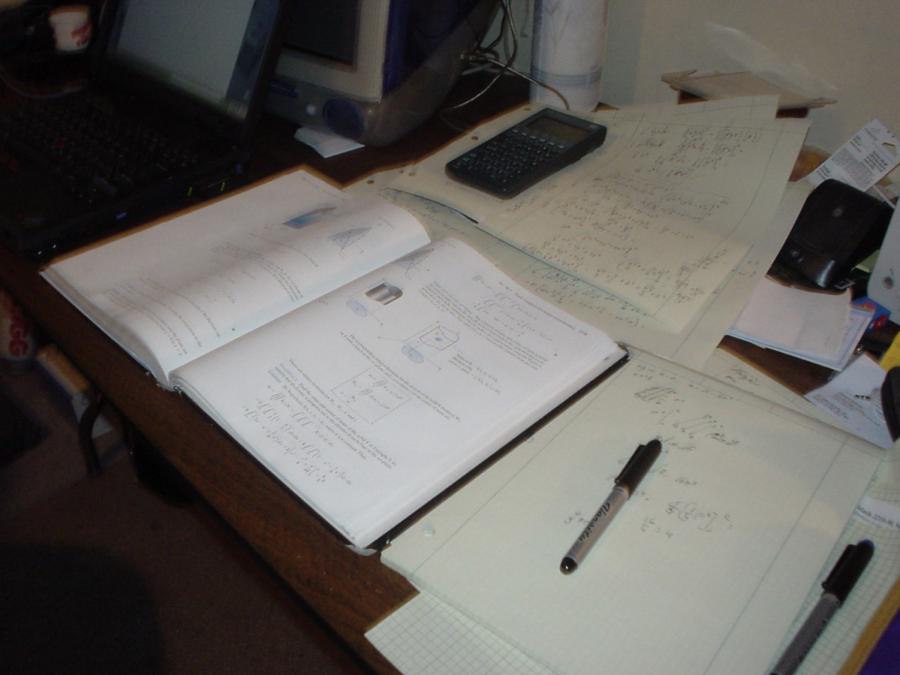 Math homework covers a student's desk.