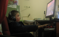 This boy is engrossed in an online video game, which provides powerful benefits.