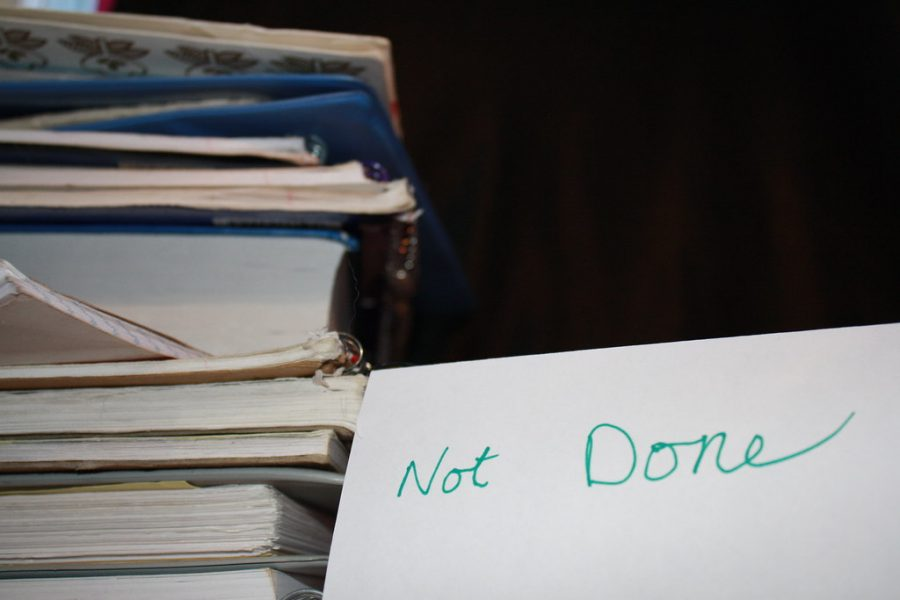 Books build up: As a procrastinator it is hard to stay on top of your work.