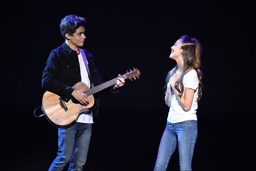 Olivia Rodrigo sings with High School Musical: The Musical: The Series costar Joshua Basset at the 2019 D23 Expo.