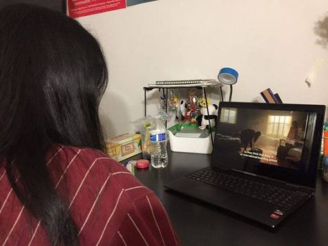 Senior Valerie Zhao watches the pilot of Fate: The Winx Saga.