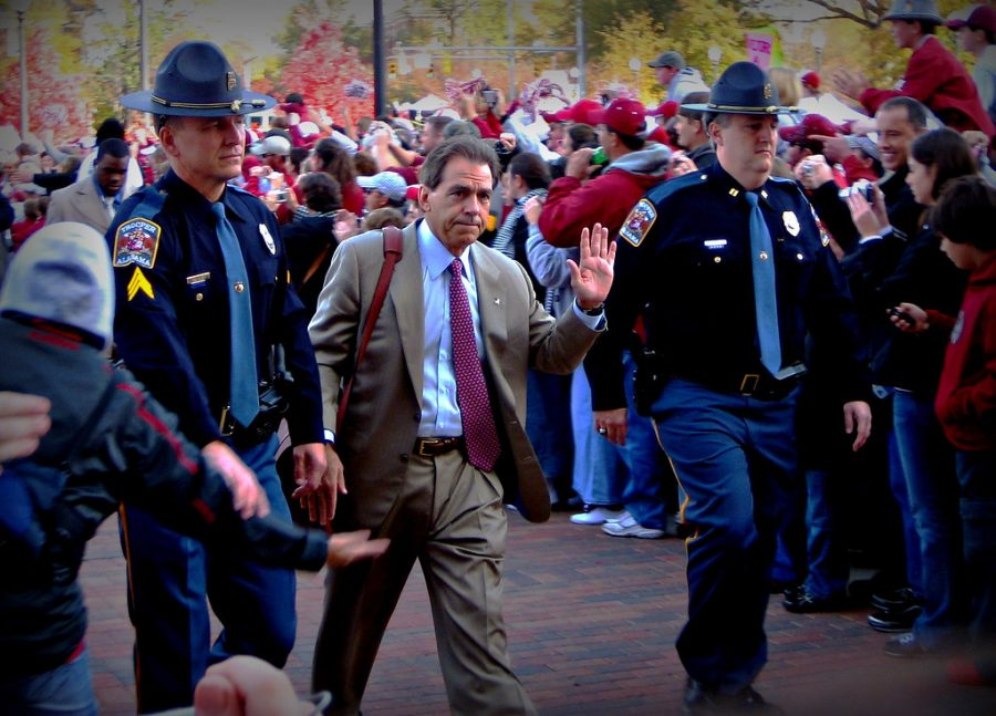 Alabama Head Coach Nick Saban excites the crowd as he enters the stadium for a home football game. Saban has been supportive of DeVonta Smith.