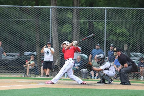Junior Brady Weiss takes a swing in a summer game following the cancellation of the spring season due to COVID.