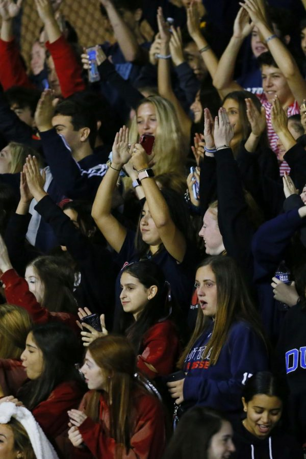 Students cheer for the football team during homecoming in 2019. Fans will be prohibited from coming to athletic events this spring.