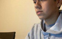 Senior Sebastian Maldonado-Arango checks his quarter grades on the Synergy Website.