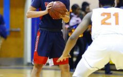 Senior William Margarites takes the ball up the court last year against Watkins Mill during the 2019-2020 season.
