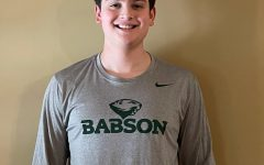 Senior Tyler Konigsberg celebrates his future endeavors in his new Babson College merchandise.
