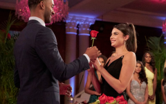 Bachelor Matt James gives a rose to contestant Rachael Kirkconnell at the rose ceremony.